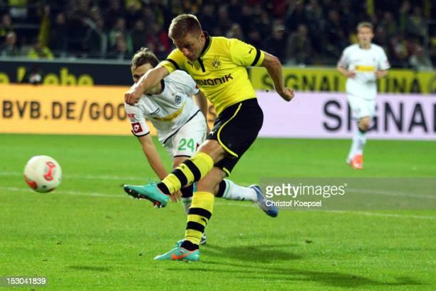 Jakub Blaszczykowski of Dortmund scores the fifth goal during the Bundesliga match between Borussia Dortmund and VfL Borussia Moenchengladbach at...