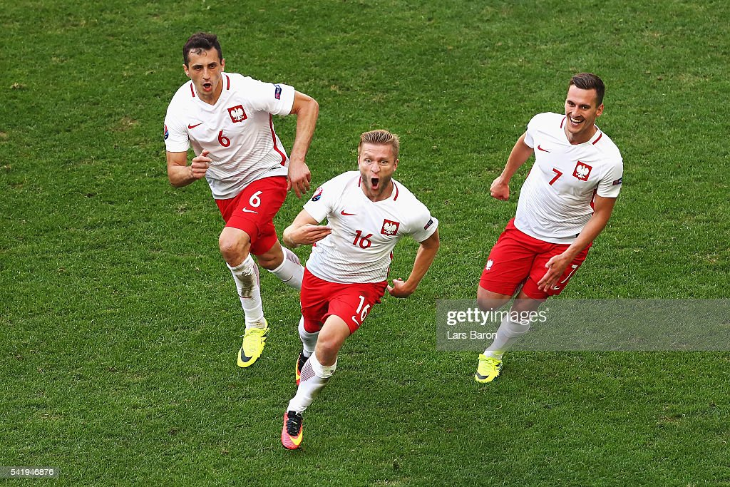 Jakub Blaszczykowski of Poland (C) celebrates scoring his team's first goal during the UEFA EURO 2016 Group C match between Ukraine and Poland at Stade Velodrome on June 21, 2016 in Marseille, France.