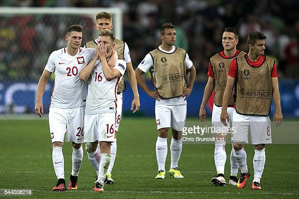 Jakub Blaszczykowski of Poland is consoled by teammate Lukas Piszczek at fulltime following the UEFA Euro 2016 Quarter Final match between Poland and...