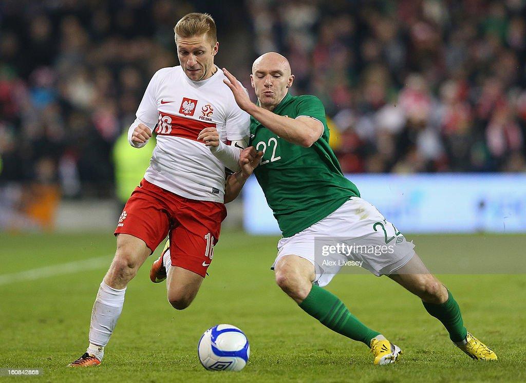 Jakub Blaszczykowski of Poland is tackled by Conor Sammon of Republic of Ireland during the International Friendly match between Republic of Ireland and Poland at Aviva Stadium on February 6, 2013 in Dublin, Ireland.