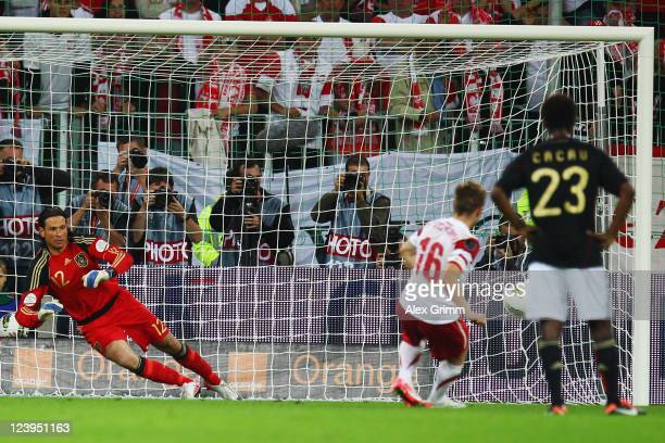 Jakub Blaszczykowski of Poland scores his team's second goal with a penalty against goalkeeper Tim Wiese of Germany during the International friendly...