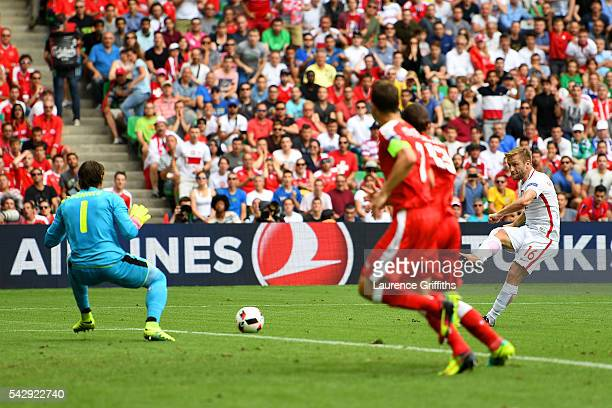 Jakub Blaszczykowski of Poland scores the opening goal past Yann Sommer of Switzerland during the UEFA EURO 2016 round of 16 match between...