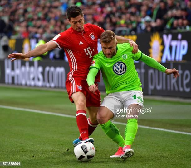 Jakub Blaszczykowski of Wolfsburg challenges Robert Lewandowski of Muenchen during the Bundesliga match between VfL Wolfsburg and Bayern Muenchen at...
