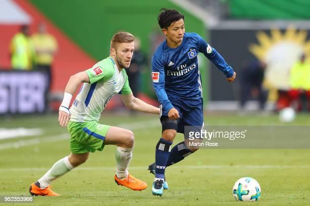 Jakub Blaszczykowski of Wolfsburg fights for the ball with Tatsuya Ito of Hamburg during the Bundesliga match between VfL Wolfsburg and Hamburger SV...
