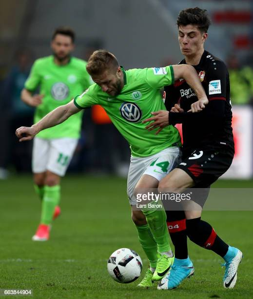 Jakub Blaszczykowski of Wolfsburg is challenged by Kai Havertz of Bayer Leverkusen during the Bundesliga match between Bayer 04 Leverkusen and VfL...