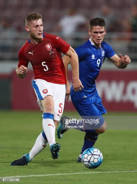Jakub Brabec of the Czech Republic beats Vidar Kjartansson of Iceland to the ball during the international friendly match between Iceland and Czech...