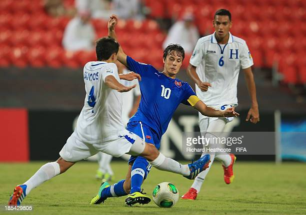 Jakub Hromada of Slovakia it tackled by Luis Santos of Honduras during the FIFA U17 World Cup UAE 2013 Group A match between Slovakia and Honduras at...