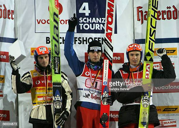 Jakub Janda of Czech Republic , Janne Ahonen of Finland and Roar Ljoekelsoey celebrate on the podium after the FIS Ski Jumping World Cup event at the...