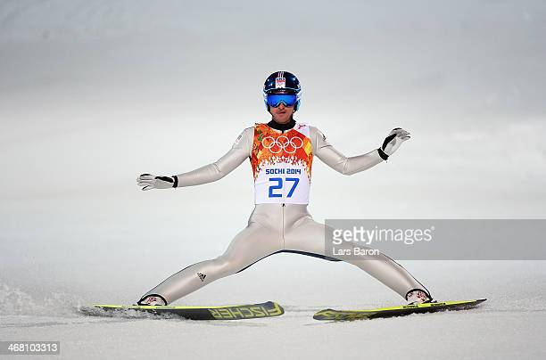 Jakub Janda of the Czech Republic lands his jump during the Men's Normal Hill Individual first round on day 2 of the Sochi 2014 Winter Olympics at...