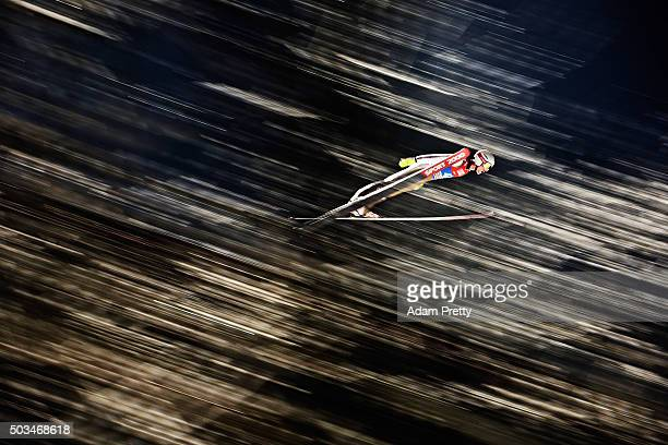 Jakub Janda of the Czech Republic soars through the air during his qualifying jump on day 1 of the Bischofshofen 64th Four Hills Tournament on...