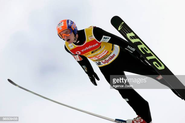 Jakub Janda of the Czech Republic stretches mid jump during the FIS Ski Jumping World Cup event at the 54th Four Hills ski jumping tournament on...