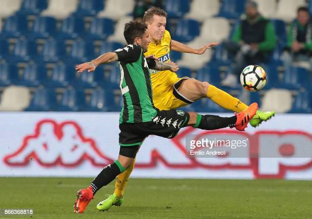 Jakub Jankto of Udinese Calcio competes for the ball with Stefano Sensi of US Sassuolo Calcio during the Serie A match between US Sassuolo and...