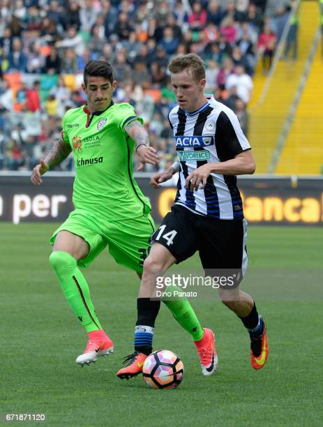 Jakub Jankto of Udinese Calcio competes with Bartosz Salamon of Cagliari Calcio during the Serie A match between Udinese Calcio and Cagliari Calcio...