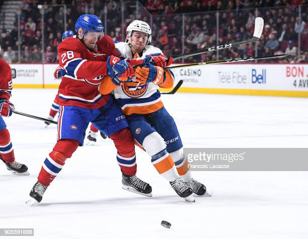 Jakub Jerabek of the Montreal Canadiens tries to slow down Anthony Beauvillier of the New York Islanders in the NHL game at the Bell Centre on...