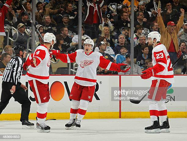 Jakub Kindl celebrates his goal with teammates Gustav Nyquist and Brian Lashoff of the Detroit Red Wings during the second period against the...