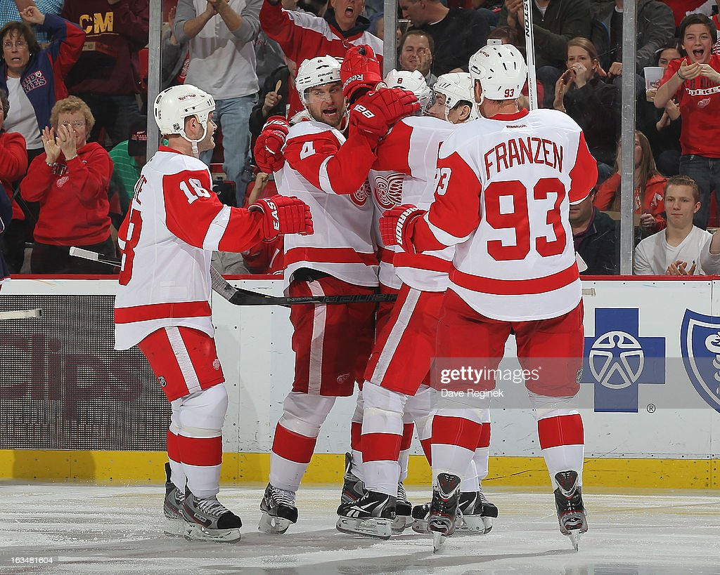 Jakub Kindl #4 of the Detroit Red Wings celebrates his goal with Pavel Datsyuk #13, Johan Franzen #93, Justin Abdelkader #8 and Ian White #18 during an NHL game against the Columbus Blue Jackets at Joe Louis Arena on March 10, 2013 in Detroit, Michigan. Columbus won 3-2 in a shoot-out