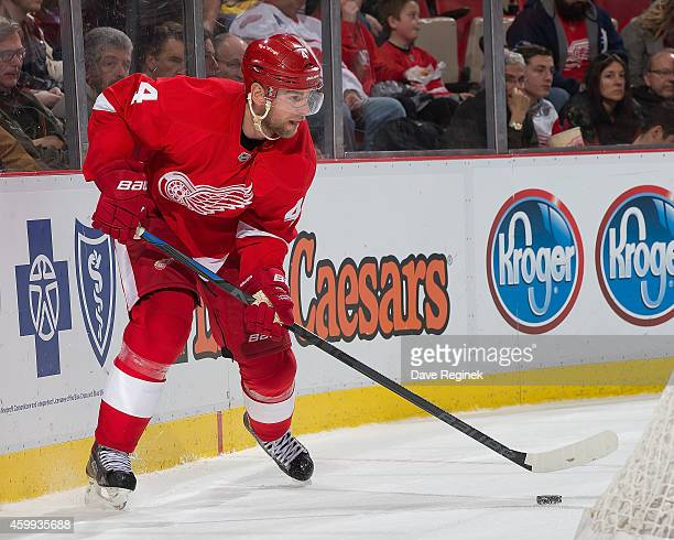 Jakub Kindl of the Detroit Red Wings controls the puck behind the net during a NHL game against the Florida Panthers on December 2 2014 at Joe Louis...