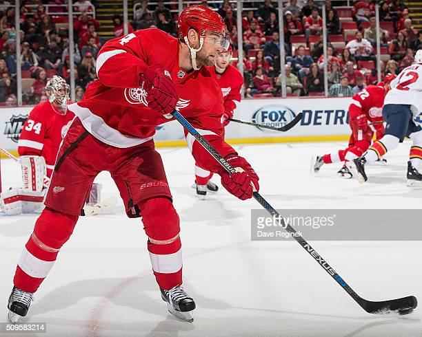Jakub Kindl of the Detroit Red Wings passes the puck during an NHL game against the Florida Panthers at Joe Louis Arena on February 8 2016 in Detroit...