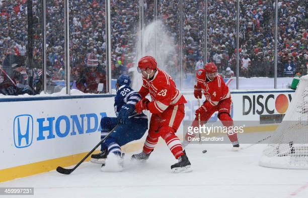 Jakub Kindl of the Detroit Red Wings plays the puck as teammate Brian Lashoff of the Detroit Red Wings cuts off Jerry D'Amigo of the Toronto Maple...