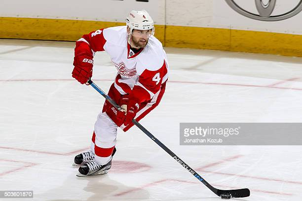 Jakub Kindl of the Detroit Red Wings plays the puck up the ice during third period action against the Winnipeg Jets at the MTS Centre on December 29...