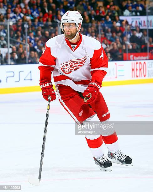 Jakub Kindl of the Detroit Red Wings skates up the ice during NHL action against the Toronto Maple Leafs at the Air Canada Centre March 29 2014 in...