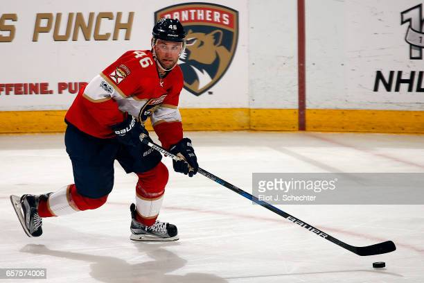 Jakub Kindl of the Florida Panthers skates with the puck against the Arizona Coyotes at the BBT Center on March 23 2017 in Sunrise Florida
