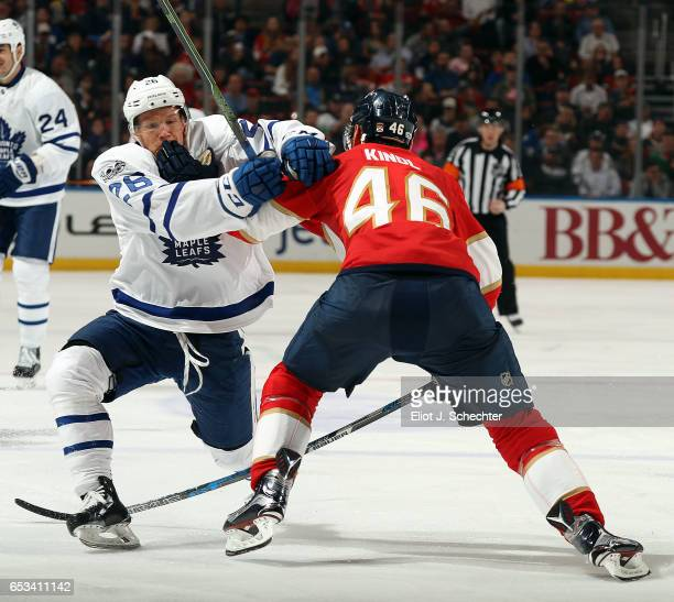 Jakub Kindl of the Florida Panthers tangles with Nikita Soshnikov of the Toronto Maple Leafs at the BBT Center on March 14 2017 in Sunrise Florida