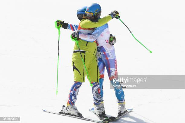 Jakub Krako of Slovakia and his guide Branislav Brozman celebrate after competing in the Alpine Skiing Men's Slalom Visually Impaired on day eight of...