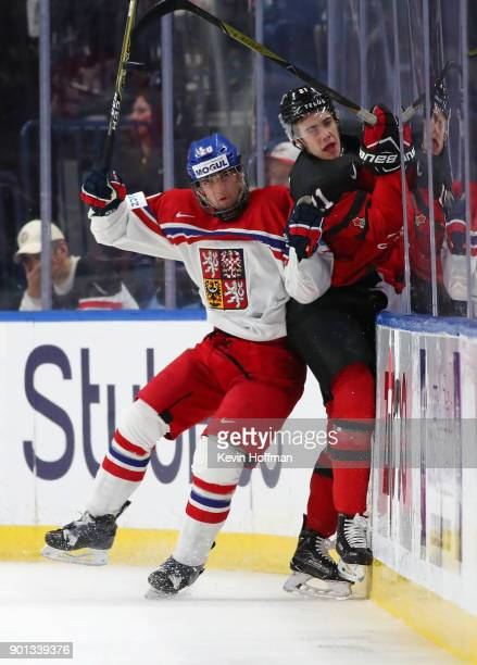 Jakub Lauko of Czech Republic checks Brett Howden in the first period during the IIHF World Junior Championship at KeyBank Center on January 4 2018...