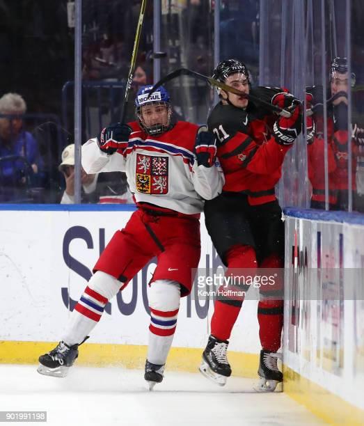 Jakub Lauko of Czech Republic checks Brett Howden of Canada during the IIHF World Junior Championship at KeyBank Center on January 4 2018 in Buffalo...