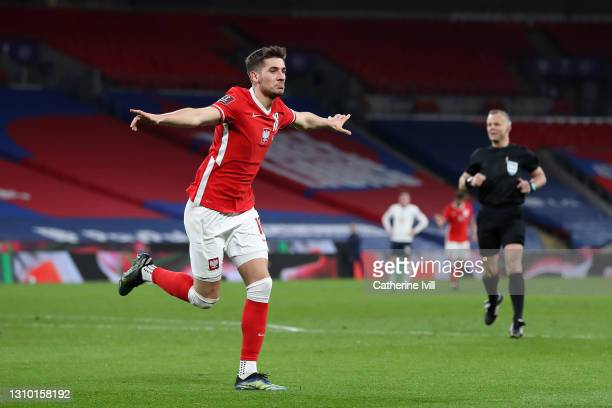 Jakub Moder of Poland celebrates after scoring their side's first goal during the FIFA World Cup 2022 Qatar qualifying match between England and...