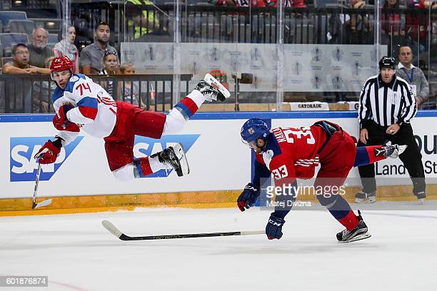 Jakub Nakladal of Czech Republic and Alexei Emelin of Russia battle for the puck during the 2016 World Cup of Hockey preparation match between Czech...