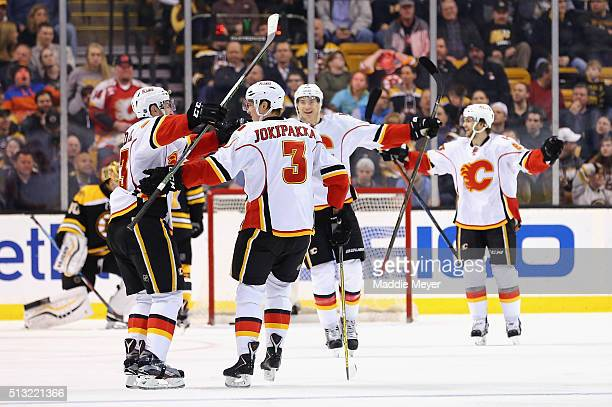 Jakub Nakladal of the Calgary Flames celebrates with Jyrki Jokipakka after scoring against the Boston Bruins during the third period at TD Garden on...