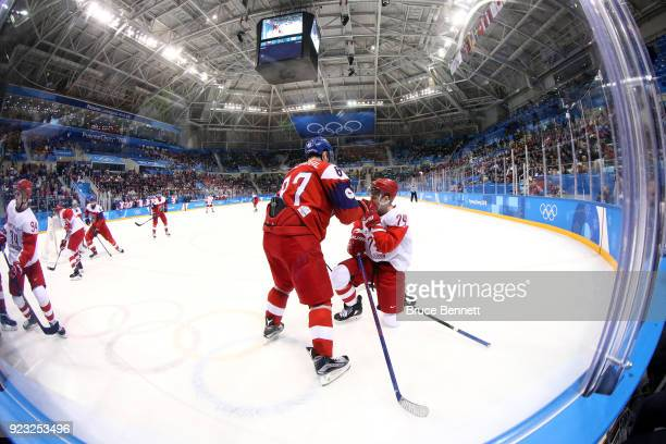 Jakub Nakladal of the Czech Republic collides with Nikolai Prokhorkin of Olympic Athlete from Russia in the second period during the Men's Playoffs...