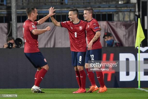 Jakub Pesek of Czech Republic celebrates with his teammate Malinsky after scoring a goal during the UEFA Nations League soccer match between Czech...