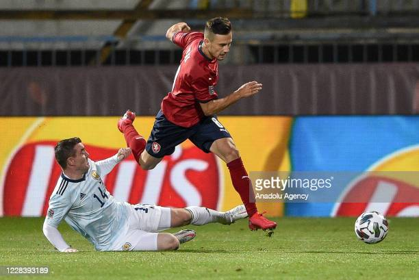 Jakub Pesek of Czech Republic in action against John Fleck of Scotland during the UEFA Nations League soccer match between Czech Republic and...