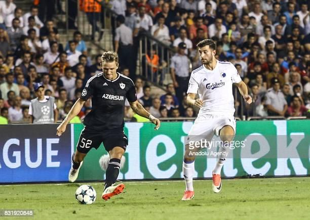 Jakub Rzezniczak of Qarabag Agdam in action against Andrija Pavlovic of FC Copenhagen during the UEFA Champions League playoff match between Qarabag...