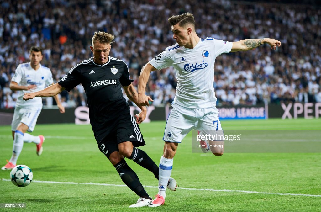 Jakub Rzezniczak of Qarabag FK and Benjamin Verbic of FC Copenhagen compete for the ball during the UEFA Champions League Playoff 2nd Leg match between FC Copenhagen and Qarabag FK at Telia Parken Stadium on August 23, 2017 in Copenhagen, Denmark.