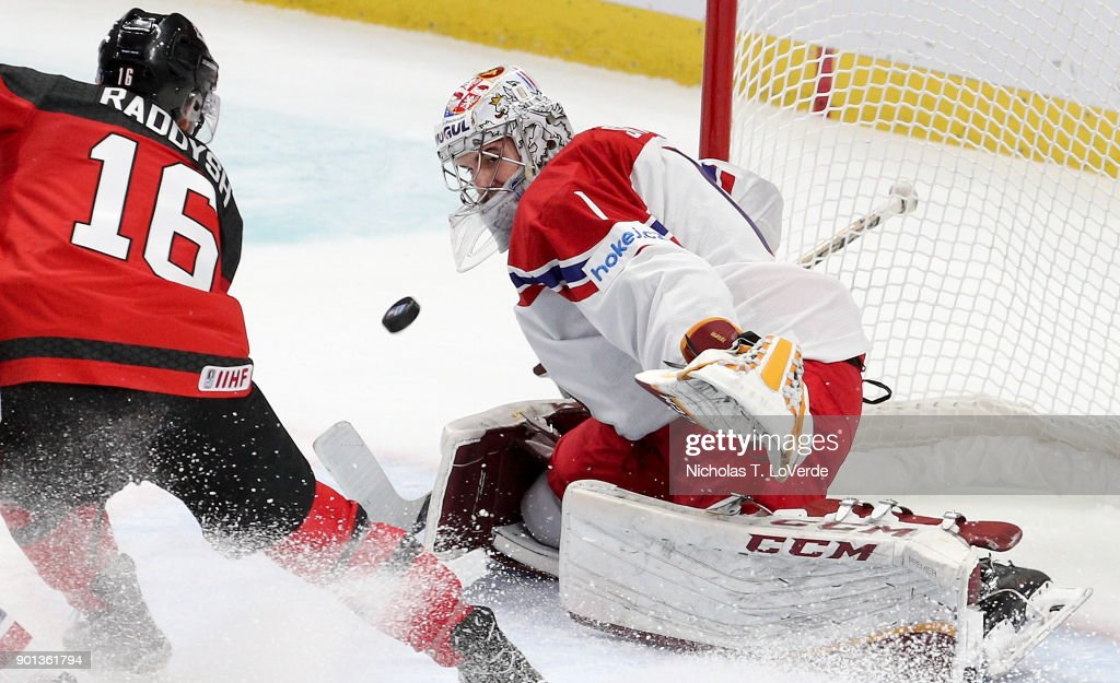 Jakub Skarek #1 of Czech Republic eyes a rebound off the stick of Taylor Raddysh #16 of Canada during the third period of play in the IIHF World Junior Championships Semifinal game at KeyBank Center on January 4, 2018 in Buffalo, New York.
