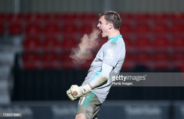 Jakub Stolarczyk of Leicester City celebrates after saving a penalty during the shootout in the Papa John's Trophy match between Salford City and...