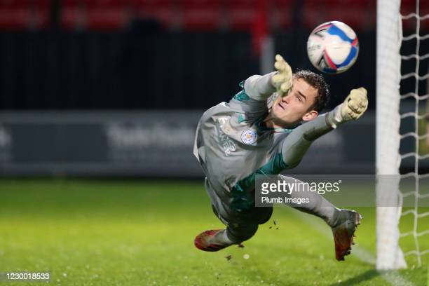 Jakub Stolarczyk of Leicester City saves a penalty during the shootout in the Papa John's Trophy match between Salford City and Leicester City at...