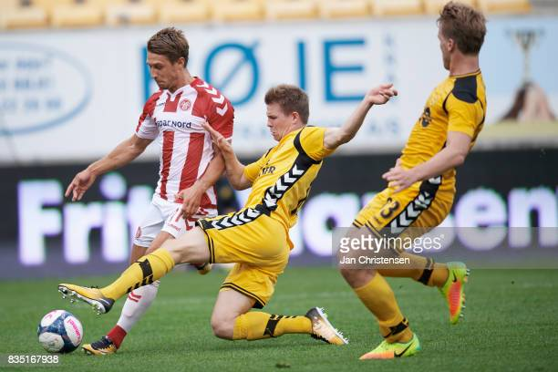 Jakub Sylvestr of AaB Aalborg and Mads Dohr Thychosen of AC Horsens compete for the ball during the Danish Alka Superliga match between AC Horsens...