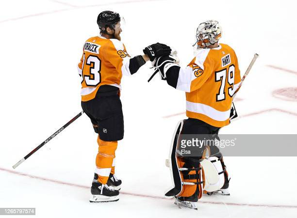 Jakub Voracek and Carter Hart of the Philadelphia Flyers celebrate the win over the Montreal Canadiens in Game One of the Eastern Conference First...