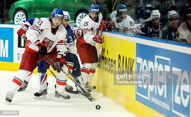 Jakub Voracek and Jan Marek of Czech Republic battles for the puck with Vincent Bachet of France during the IIHF World Championship group C match...