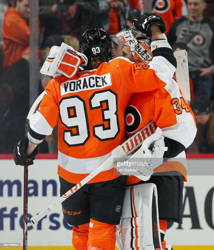 Jakub Voracek #93 and Petr Mrazek #34 of the Philadelphia Flyers celebrate after defeating the Winnipeg Jets 2-1 on March 10, 2018 at the Wells Fargo Center in Philadelphia, Pennsylvania.