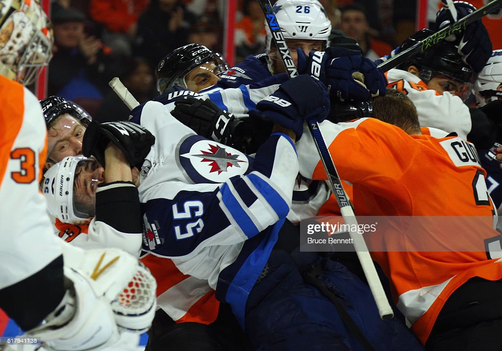 Jakub Voracek #93 (l) and Radko Gudas #3 of the Philadelphia Flyers (r) combine on Mark Scheifele #55 of the Winnipeg Jets at the Wells Fargo Center on March 28, 2016 in Philadelphia, Pennsylvania. The Flyers defeated the Jets 3-2 in overtime.