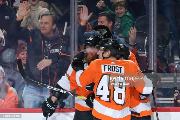 Jakub Voracek Morgan Frost of the Philadelphia Flyers and David Kase of the Philadelphia Flyers celebrate a goal against the Anaheim Ducks in the...