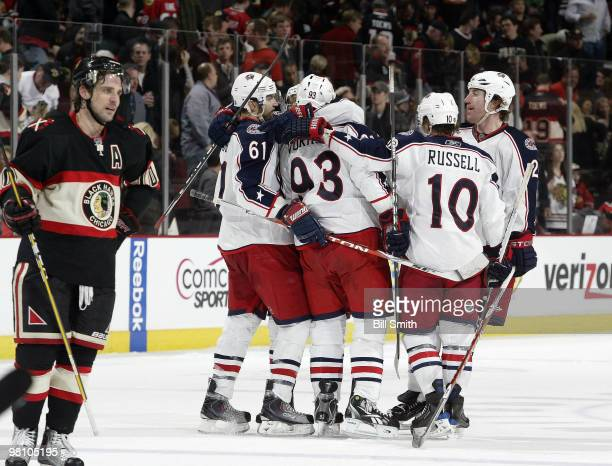 Jakub Voracek of the Columbus Blue Jackets celebrates with his teammates, including Rick Nash and Mike Commodore, after scoring his second goal of...
