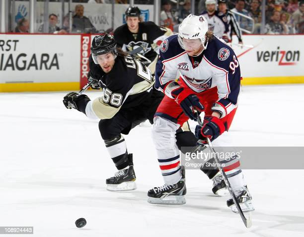 Jakub Voracek of the Columbus Blue Jackets moves the puck up ice in front of Kris Letang of the Pittsburgh Penguins on February 8 2011 at Consol...