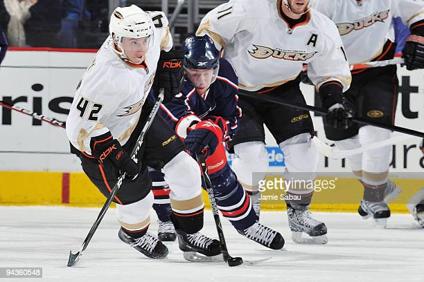 Jakub Voracek of the Columbus Blue Jackets poke checks the puck away from Dan Sexton of the Anaheim Ducks during the second period on December 12...
